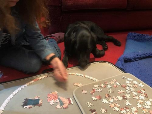 Helping Caroline with the puzzle.